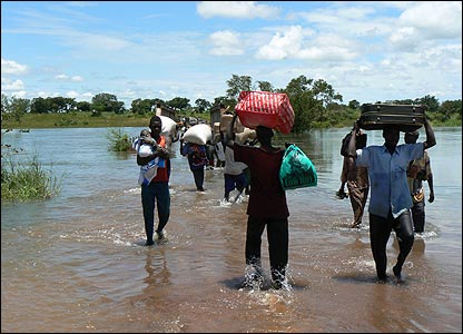 People walking through flooded river in Awali, nine km from River Moroto [Pic: Hudson Apunyo]