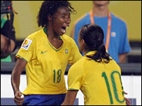 Matchwinner Pretinha (left) celebrates with Marta
