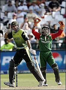 Shahid Afridi (left) departs while Bangladesh wicketkeepr Mushfiqur Rahim celebrates taking the catch to dismiss him