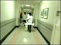Junior doctors rushing down corridor