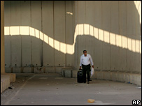 A man walks through the border crossing into Gaza