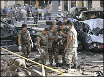 Police investigate at the scene of the car bombing in Beirut, Lebanon