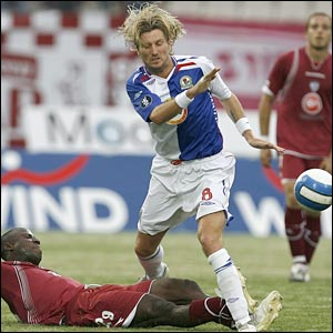 Blackburn midfielder Robbie Savage is tackled during his team's defeat against Larissa