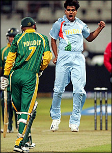 Shaun Pollock (left) avoids a celebrating RP Singh