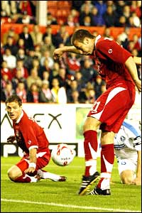 Andrew Considine shoots on goal for Aberdeen