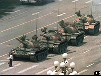 Man stands in front of tank near Tiananmen Square
