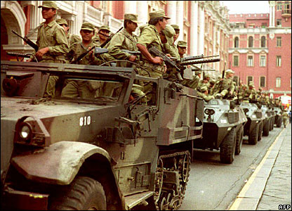 Peruvian soldiers ride patrolling the streets of Lima in May 1992 (file)