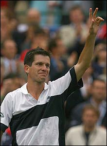 Henman salutes the crowd