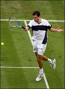 Tim Henman powers a return to Roko Karanusic