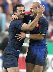 Vincent Clerc and Frederic Michalak celebrate France's first try