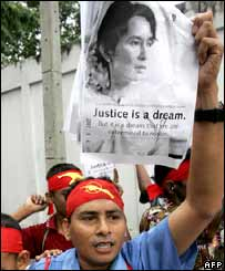 Burmese activists hold pictures of Aung San Suu Kyi during a protest outside the Burmese embassy in Bangkok, Thailand, on 16 September 2007.