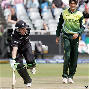 McCullum scampers to safety as Sohail Tanvir looks on