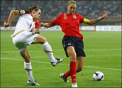 Heather O'Reilly contests possession with Faye White