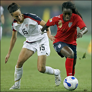 Eniola Aluko tries to find space to send in a cross