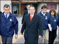 Police led Mr Fujimori away from his home in Santiago, Chile (AP Photo/Kyodo News, Kazushige Motokura 22/09)