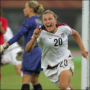 Wambach celebrates scoring on her 100th appearance