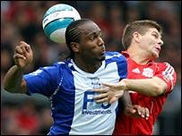 Birmingham's Cameron Jerome battles with Liverpool captain Steven Gerrard