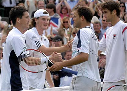 Tim Henman and Andy Murray shake hands with Croatia's Lovro Zovko and Marin Cilic