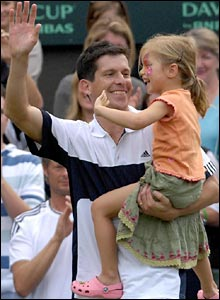 Tim Henman and daughter Rosie acknowledge the Wimbledon crowd