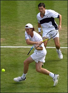 Jamie Murray and Tim Henman at the net during their match