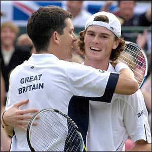 Tim Henman and Jamie Murray embrace after their victory