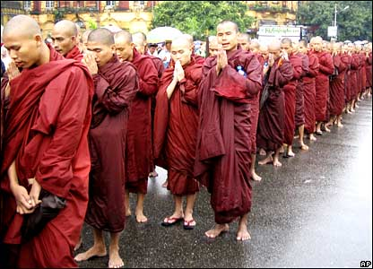 Buddhist monks march and pray during an anti-junta protest in Rangoon on Saturday 22 September 2007