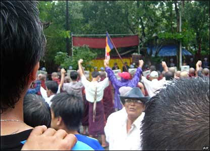 This photo provided by the Mandalay Gazette shows monks outside the house of Aung San Suu Kyi on Saturday 22 September 2007