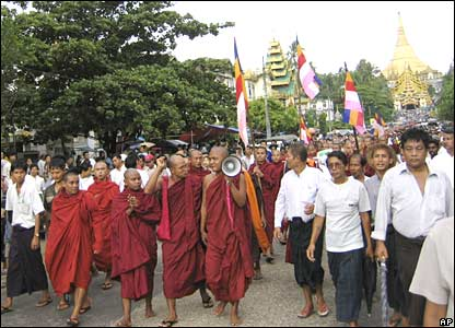 Buddhist monks march and pray during an anti-junta protest in Rangoon on Sunday 23 September 2007