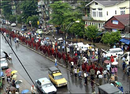 In this photo released by Democratic Voice of Burma, Buddhist monks, accompanied by civilians, march on a street during an anti-junta protest in Rangoon on Saturday 22 September 2007