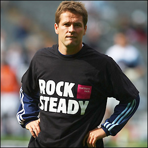 Michael Owen warms-up for the match