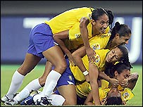 Brazil celebrate taking the lead but they were pegged back before eventually winning