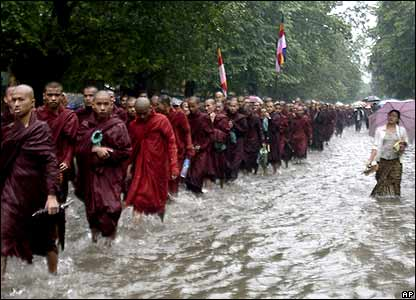 Buddhist monks march through heavy rain during an anti-junta protest in Rangoon on Saturday 22 September 2007