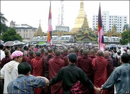 Civilians linking hands to protect the monks.