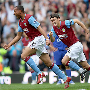Carew celebrates his 14th-minute strike with Gareth Barry