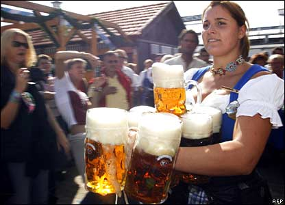 A waitress serves customers in a beer tent during the official opening the Oktoberfest beer festival in Munich