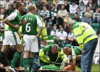 Hibernian v Celtic: There is concern for the Hibs players as Fletcher needs medical attention before being substituted by Dean Shiels