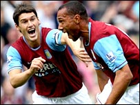 John Carew and Gareth Barry celebrate