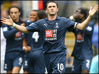 Robbie Keane celebrates his opener for Spurs
