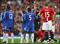 Mikel (left) sees red after his tackle on Patrice Evra (sat on the floor)