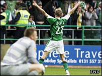 Dean Shiels celebrates his late goal as Artur Boruc is left to ponder his mistakes