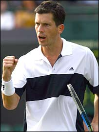 Tim Henman pumps his fists at Wimbledon