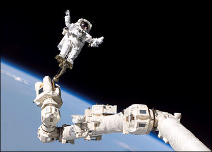 Stephen Robinson on the Canadarm. Image: Nasa.