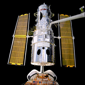 Hubble space telescope lifted from shuttle. Image: Nasa.