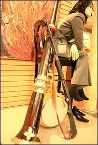 A Tibetan trumpet, shotgun, snare drum and model