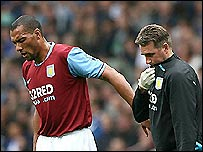 Aston Villa striker John Carew (left) limps off during the 2-0 win over Everton