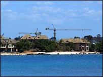 Cranes behind Mauritian beach hotels