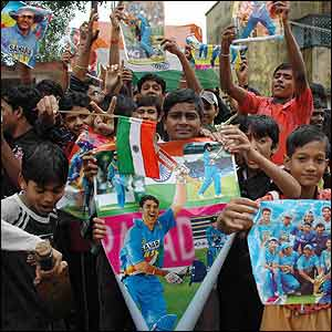 In India, young fans gather outside the home of captain Mahendra Singh Dhoni
