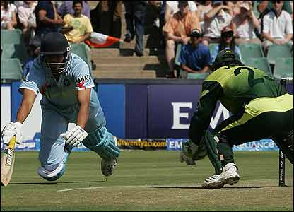 Indian debutant Yusuf Pathan has to dive to avoid being run out off the first ball of the match