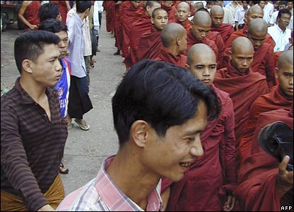Buddhist monks, accompanied by civilians, protest on 23 September 2007