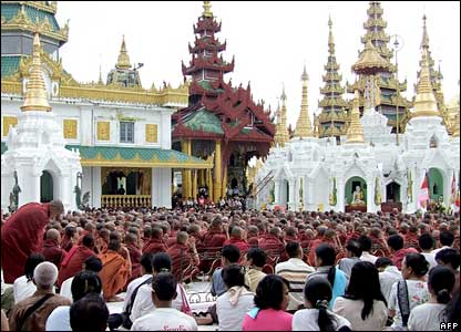 Monks and civilians sit at the Shwedagon Pagoda in Rangoon